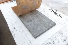Make rubber mold with wood grain, then cast concrete. (I'll never do it, but it looks so cool!)
