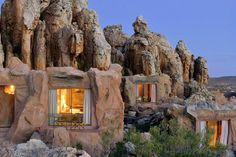 The unique 'cave suites' built against the sandstone rock formations at Kagga Kamma Private Game Reserve Bed and Breakfast located in the Cederberg Mountains, Ceres, Cape Winelands, Western Cape, South Africa. #travel #unusual #hotels