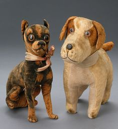 Pair of Antique toy dogs, the one on the left looks just like a Manchester or Black & Tan Toy Terrier
