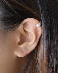 Dotted Cuff Earring by Olive Yew. This handcrafted multi-dot stamped ear cuff is lightweight and easy to wear. Wear this thick earring cuff on the helix/cartilage area of ear.