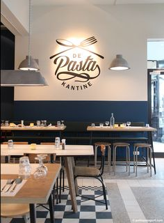 Great logo. Walls - lower blue, upper white with logo and pendant fixtures, wood table tops