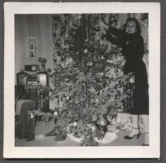 Vintage Photo Woman w/ Christmas Tree & Radio Home--definitely NOT my Mom!  She always felt that those big consoles were a waste of money and wood--they had the same innards as a small radio.