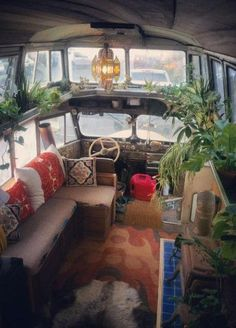 "Ryan Lovelace converted this vintage bus into a very livable space, including an overhead extension that serves as a sleeping loft! We love that he named it ""The Cosmic Collider.""  Photo:  TheCosmicCollider, Tumblr"