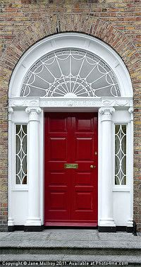 Photo about Georgian doorway in Dublin, Ireland, with cast iron fanlight and ionic columns. Image of brickwork, pillar, grey - 2971008 Georgian Buildings, Georgian Architecture, Front Door Design, Front Door Colors, Georgian Doors, Georgian House, Door Accessories, Door Furniture, Wall Art For Sale