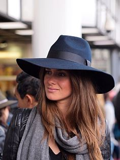 b522f0cb50b Wide brimmed navy wool fedora looks stunning styled with grey scarf and  black leather jacket.