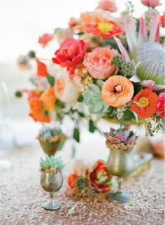 Colorful floral centerpiece surrounded by succulents in vintage cups. #succulent #wedding #flowers