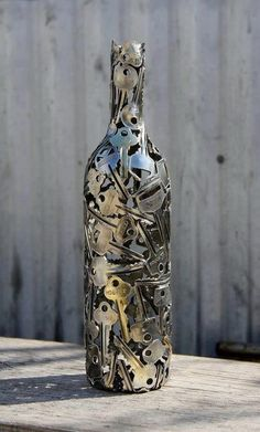 Keys in bottle... cool! This looks hard but it's not..a little time consuming..work on it while watching tv...see the results
