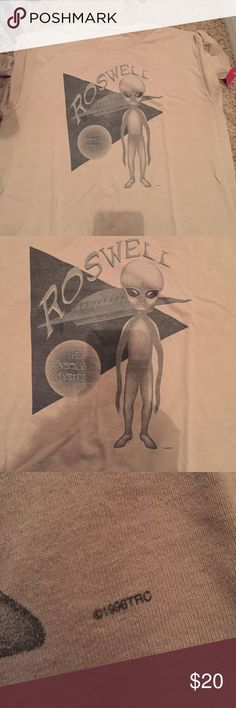 Vintage Roswell alien shirt Very good used vintage condition. Not sure the size because the tag is missing, but I'm guessing it's a large. Tan color. Straight from the 90's ✌️still has tag. Vintage Tops Tees - Short Sleeve