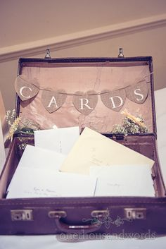 Vintage suitcase for wedding cards at Bournemouth Hotel Wedding. Photography by one thousand words wedding photographers