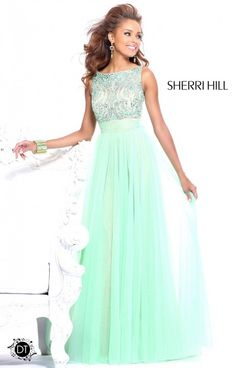 Sherri Hill 11022 is certainly a very special dress! A perfect touch of Sherri Hills pretty design and girly nature has made this a popular look. The rhinestone top enhances the layered skirt, and the bow in the back is the perfect finishing touch! The layers of fabric that make up the skirt are ultra flattering to the leg.
