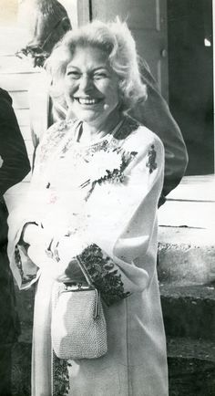 Charlotte, her husband Maurice just behind her, at their daughter's wedding to Ned Shank. October 20, 1977, Wenona Springs Church, Eureka Springs, Arkansas. Their daughter: Crescent Dragonwagon, writer, who is pinning this pucture. Photographer: Louise Terzia