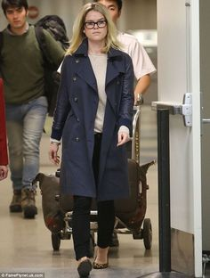 Alice Eve looks effortlessly chic in a navy trench and thick-rimmed glasses as she touches down at LAX | Mail Online