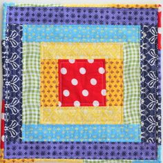 The Taste the Rainbow Mini Quilt is one of our favorite easy log cabin quilt patterns. This gorgeous rainbow mini quilt is perfect for quilt blocks, doll quilts, coasters, and all kinds of other quilt projects!