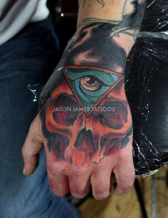 Neo traditional skull and eye hand piece tattoo by Jason James