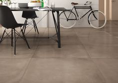 """Origini by Imola design marks a new frontier in experimentation: ceramic tiles inspired by acid stained concrete. Sizes: 35.5"""" x 35.5"""", 18"""" x 36"""", 24"""" x 24"""", 13"""" x 24"""". Colors: Beige, Cappuccino, White, Grey and Black.  #Cersaie2016 #GrittyChic"""