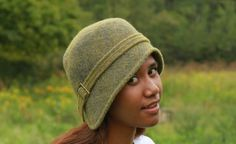 This is an extra-soft, super-luxurious hat made from our unique wool felt.  We start with the carded fiber and create this felt by hand on a FeltLoom.  We lay out one color of fiber on top of another color, so that there is an interesting blend and richness to each felt.  Using Nora's own pattern, we sew our hats and block them on wooden forms so that the shape and fit are perfect!  These hats are finished with an adjustable buckle.  The result is a cozy, delicious and crazy-beautif...