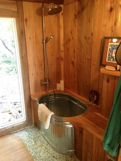 rustic metal tub suits this little cabin bathroom keva tiny house salt spring island