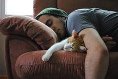 sleeping man with cat