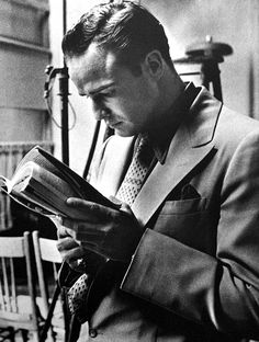 """When there's down time on the """"Guys and Dolls"""" set, Marlon Brando just looks for a wall to lean against and pulls out a paper-back -- or it could be a magazine. Light reading material for a lighter-weight movie/musical. Photo by Phil Stern, Marlon Brando, People Reading, Book People, I Love Books, Books To Read, Reading Books, Classic Hollywood, Old Hollywood, Hollywood Actresses"""