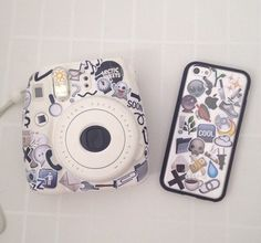 White Instax Mini 8 and iPhone case covered in a collage of emoji stickers case, sticker, and goals Polaroid Cases, Polaroid Instax, Instax Mini Camera, Fujifilm Instax Mini 8, Cute Camera, Best Camera, Accessoires Photo, Photography Camera, Iphone Case Covers
