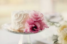 white wedding cake with pink peony flowers