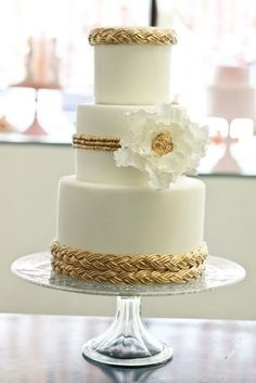 Gold Accents for the Wedding Cake - Edible gold powder is expensive. Gold braid, ribbon or ric rac will be on clearance after Christmas and can be used on your cake to add gold without adding cost.