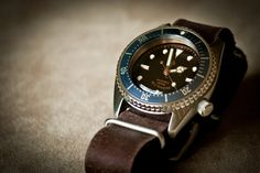https://flic.kr/p/dFSVPQ   Seiko SKX013 'Tudor 7924 Style'   A quick pic of my latest mod, a vintage Tudor inspired midsize Seiko diver.  Just needs a nicer crown to finish it off.