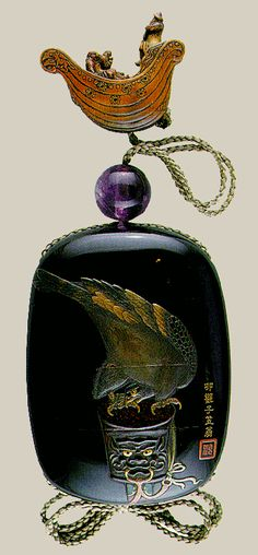 The sagemono in the image is an inro made by the famous seventeenth century lacquer artist Ritsuou. Japanese lacquer work is unique in Asia, involving the sprinkling of gold and silver powder onto the surface. Lacquer art was extremely difficult; one inro could take years to be completed. This inro (11 x 8 cm) displays a falcon tied to a perch shaped as a demon's head.