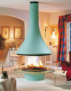 Hanging Fireplace ideas and designs to improve your home decoration. You can pick any hanging fireplace design that you prefer to built in your home. Hanging Fireplace, Living Room With Fireplace, Style At Home, Ceiling Hanging, Ceiling Lights, Fireplace Design, Fireplace Ideas, Fireplace Mantels, Home Decor Inspiration
