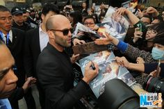 "Movie star Jason Statham signs autographs for his fans at a press conference for the new ""Fast & Furious"" movie Furious 7 in Beijing, China, March 26, 2015. The movie will hit Chinese mainland screen on April 12"