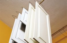 Paint both sides of cabinet doors in one day with this drying method.
