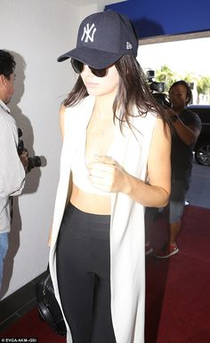 d8d8cb365a2 Kendall Jenner flaunts her taut midriff to catch a flight at LAX. Chanel  ModelYankees ...
