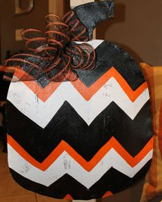 Chevron Striped Halloween Pumpkin door hanging with deco mesh bow. $38.00, via Etsy.