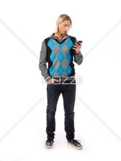 young man reading text message on cellphone. - Young man reading text message on cellphone while standing against white background, Model: Ryan Thimmig