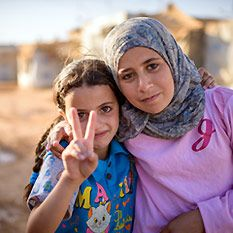 Two Syrian girls gave a peace sign