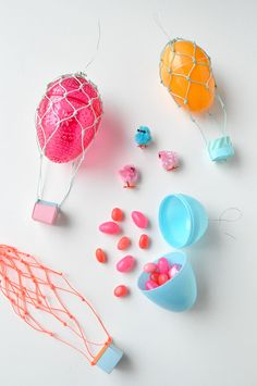 """This is one the cutest Plastic Egg Crafts I have seen recently. Not only does a plastic egg lend itself so perfectly as a """"hot air balloon"""", but I love how these little eggs are also filled with some tasty…"""