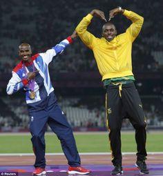 Sharing the glory: Jamaica's Usain Bolt celebrates with Britain's Mo Farah on the podium