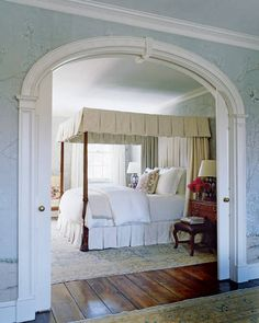 In the master bedroom, the antique mahogany four-poster features bedding and a throw by Nancy Koltes Fine Linens  and a pillow of a Robert Kime  silk from Hollyhock; the wallpaper is by De Gournay. Click here  to see the resources.   - ELLEDecor.com