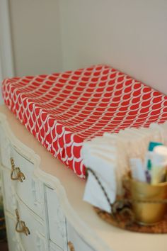DIY changing pad cover.  Worked beautifully for me (although I would recommend a slightly longer piece of elastic).