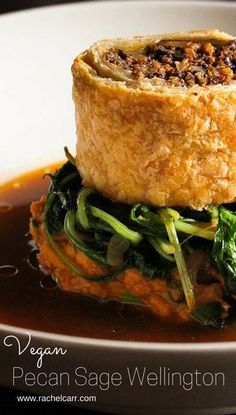 An elegant vegan version of a traditional Wellington! Puff pastry stuffed with portobello, pecans and sage, on a bed of sweet potatoes, and mushroom jus