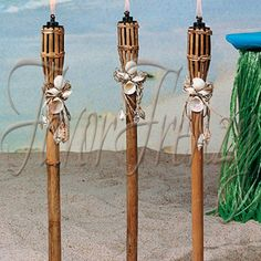 Tiki torches with shell decor! This is perfect for a beach themed wedding! - I definitely want these in my wedding. I can't wait to decorate. Luau Wedding, Wedding Reception Decorations, Destination Wedding, Dream Wedding, Beach Weddings, Green Weddings, Themed Weddings, Perfect Wedding, Summer Wedding