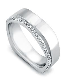 Diamonds encircle this handsome white gold Men's Wedding Band from Mark Schneider.
