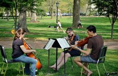 Located on UNC's central campus is McCorkle Place, home to the famous Davie Poplar.  This spot is ideal for reading, playing Frisbee, having a picnic or as these students demonstrate, a place to practice instruments.  Photo by Dan Sears, UNC News Services