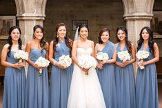 Bride Lidia with her girls wearing the Jenny Yoo 'Aidan' in Dusty Blue. Discover more bridesmaid dresses to rent at vowtobechic.com
