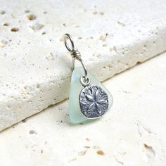Sand+Dollar+Pendant++Seafoam+Sea+Glass+&+by+sweptfromthesea,+$25.00  for momma