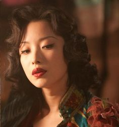 Ni Ni, actress ( Flowers of War ); this movie is amazing and brutal. And, the fashion is awesome! a  must see.
