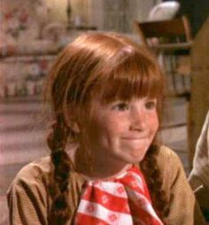 Elizabeth Walton from The Waltons.  She is so adorable! I really want a little red-headed girl. =)