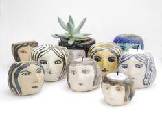 Ceramic girls' heads made by Kaye Blegvad.
