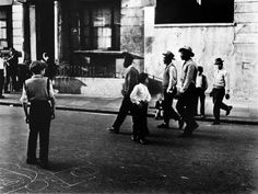 West Indian men walk through street, United Kingdom, photograph by Roger Mayne. Roger Mayne, Eugene Smith, London History, British History, Brassai, London View, Robert Frank, West Indian, African Culture