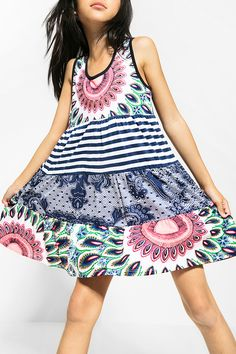 Desigual white sleeveless dress with an amazing combination of prints and colors. Discover Desigual Kids collection!